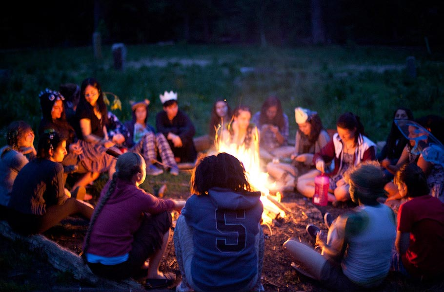 Make smores at a bonfire in Crum Meadow
